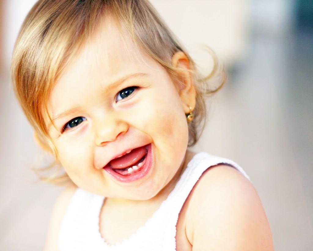 bigstockphoto_Laughing_Baby_1491039-1024×820